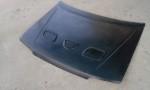 Přední kapota Mazda 323 GTR.Cena v základním provedení: 2 500,- Kč