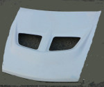 Přední kapota Mit EVO 6.Střední díl používaný jako uni. Cena v základním provedení: 1 500,- Kč