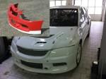 Přední nárazník.Mitsubishi Lancer Evo 9.Cena v základním provedení: 3 800,- Kč.Hmotnost výrobku od 3,8 kg